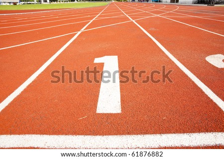 tracks on red field - stock photo