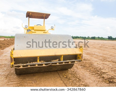 Tractor in sunset plowing the field preparing land with seedbed cultivator - stock photo