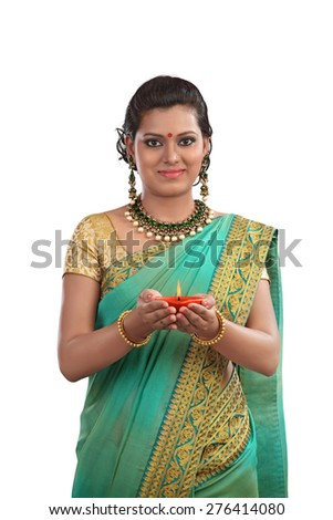 Traditional Indian woman holding the oil lamp - stock photo