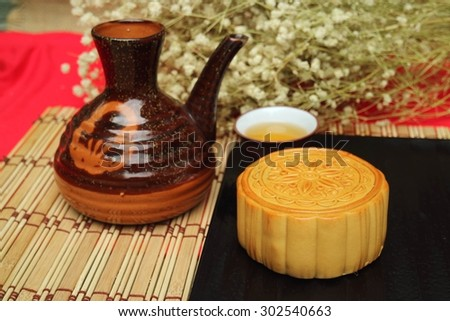 Traditional mooncakes and tea on table with teacup, Retro vintage style Chinese mid autumn festival foods
