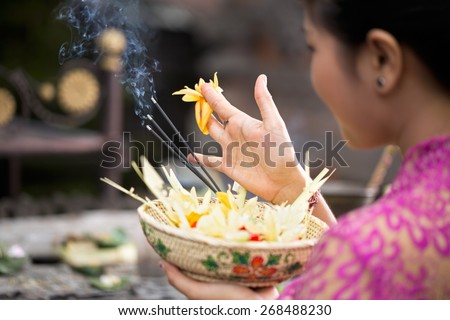 traditional offering for gods with aroma sticks - stock photo