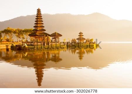 traditional religious Hindu procession in Ulun Danu temple Beratan Lake in Bali Indonesia - stock photo