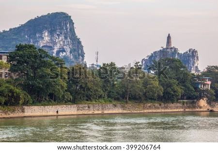 Trans mountain and Pagoda Hill of Guilin. Guilin is a city surrounded by many karst mountains and beautiful scenery in China. - stock photo