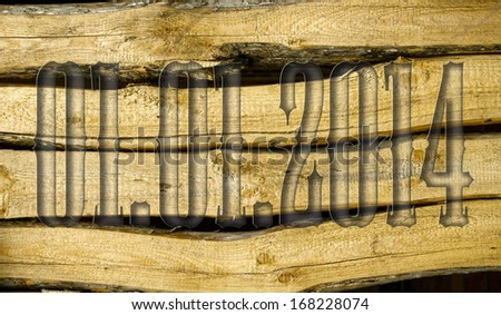 01.01.2014 transparent embossed on wooden background