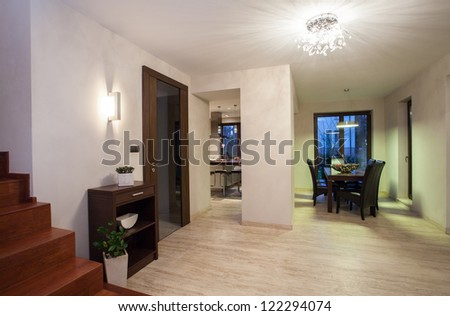 Travertine house - hallway with kitchen and dining room as a background - stock photo