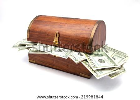 treasure trove full of dollar bills - stock photo