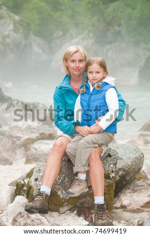 Trekking with mother in misty morning