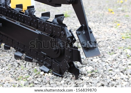 Trench digger industry detail machine for trenching - stock photo