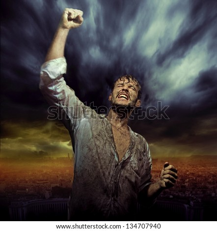 Triumphant man over night city sky - stock photo