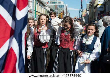 Tromso / NORWAY - on May 17, 2015: A public holiday in Norway. Norwegians at traditional celebration and parade on Storgat Street