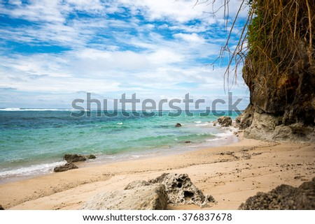 Tropical beach with transparent azure sea, beautiful bay