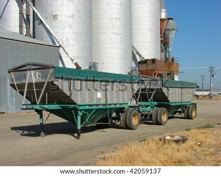 Truck trailer in front of grain elevators - stock photo