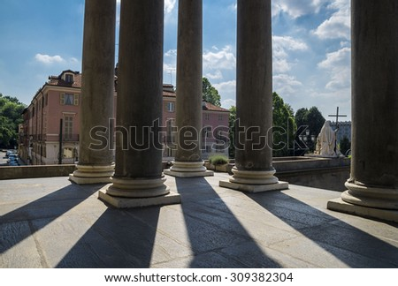 Turin, Italy, Europe - JUNE 28, 2015 . Lights and shadows through the columns of The Gran Madre di Dio Church in Turin.  - stock photo