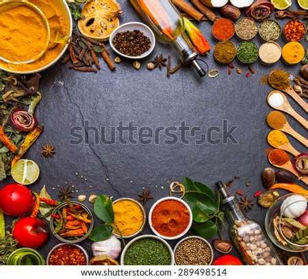(Turmeric, Pepper, Chilli)Spices and herbs on stone background, Top view indian mix spices and herbs difference ware on stone background with copy space for design spices, herbs or foods content. - stock photo