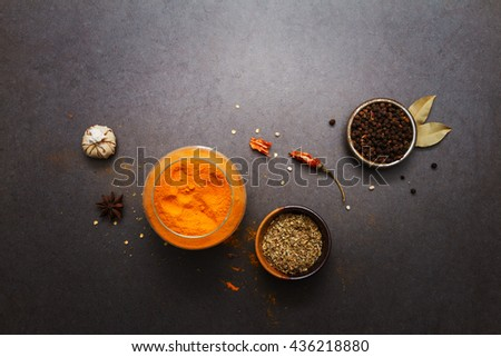 (Turmeric powder) Spices and herbs on stone background, Top view mix indian spices and herbs difference ware on stone background with copy space for design vegetable, spices, herbs or foods content. - stock photo