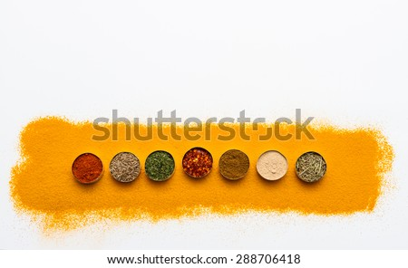 (Turmeric powder) Spices and herbs on white background, Top view mix indian spices and herbs difference ware on white background with copy space for design vegetable, spices, herbs or foods content. - stock photo