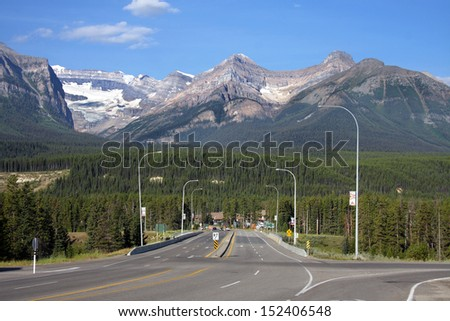 Turn off to Lake Louise. Mountains left to right, Victoria, Whyte, Niblock, St. Piran. - stock photo