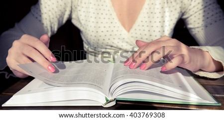 Turns the pages of the book - stock photo