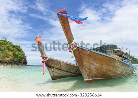 Two boats moored on the coast near the white beaches and beautiful at Thale Waek or Separated Sea in krabi, thailand - stock photo