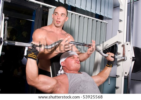 Two Bodybuilders training in the gym - stock photo