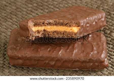 two chocolate coated biscuits filled with orange cream                          - stock photo