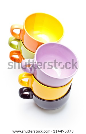 Two color cups tower on white background