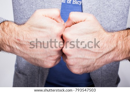 two fists, two men's hands