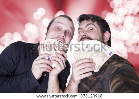 two funny men with money - stock photo