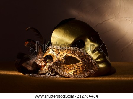 Two golden Venetian masks , focus on foreground - stock photo
