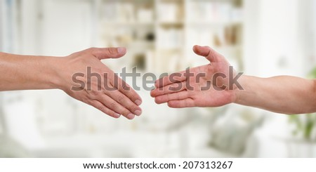 Two hands before handshake with colorful background