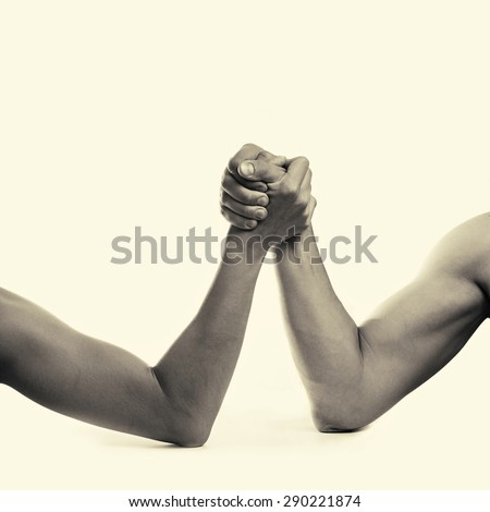 two hands depicting the rivalry of men and women - stock photo