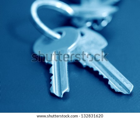 two keys in blue tone - stock photo