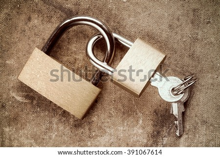 Two linked padlocks symbolizing togetherness or relations