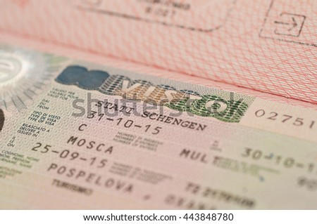 two Russian foreign passport, Chelyabinsk, Russia - June 24, 2016, two Russian foreign passport burgundy close-up on a white background - stock photo