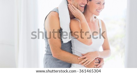 two smiling people in the gym - stock photo