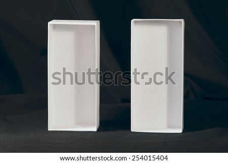 two white boxes on a black background - stock photo