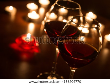 Two wineglasses in candlelight - stock photo