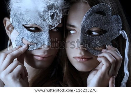 Two woman with half broken mask/Mask ball - stock photo