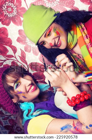 Two young artist's with with drawing tools - stock photo