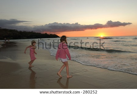 """Two young girls standing on the beach, Big Island, Hawaii, (Keith Levit)"""