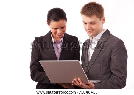 two young white collars looking at the laptop screen