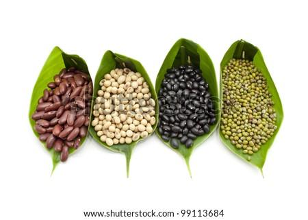 4 type of raw beans on white background - stock photo