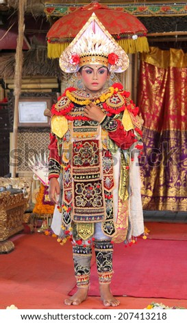 UBUD, INDONESIA-April 13: A costumed dancer performs a traditional Balinese dance with elaborate makeup and costuming before an audience on April 13, 2014.