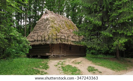 Ukrainian Ancient Wooden Hut. Wood And Straw. Near The House, Nature, Trees
