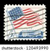 "UNITED STATES - CIRCA 1963: stamp printed in United states, shows image of White House and American Flag, series ""Flag Issue"", circa 1963 - stock photo"