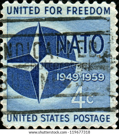 UNITED STATES OF AMERICA - CIRCA 1959: A stamp printed in the United States of America shows NATO Emblem, 10th anniversary of North Atlantic Treaty Organization, circa 1959 - stock photo