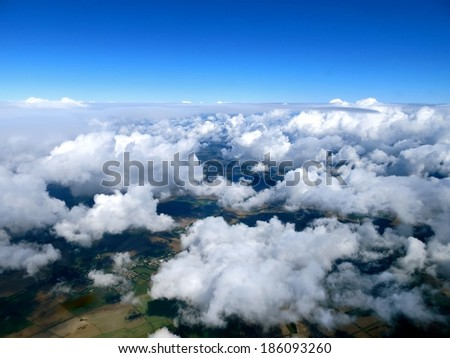 Unusual aerial view of clouds and blue skies above the earth.                               - stock photo