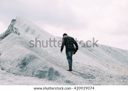 up obstacles man mountain holding arrow business  - stock photo