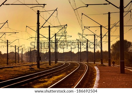 urban railway track with confusing lines and overhead cables - stock photo