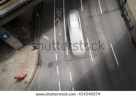 Urban Street Downtown. Overhead view of a big city, urban street. Slow shutter speed creates the motion blur.                             - stock photo